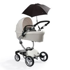 white mima xari in carrycot mode with black softgoods and parasol  - old model white pushchairs currently out of production
