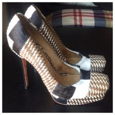 """♣️Gwen Stefani L.A.M.B houndstooth pony hair pumps L.A.M.B. BY GWEN STEFANI JUVA HOUNDTOOTH PUMPS . Size 5. Mint condition. This print haircalf pumps feature a square toe and topstitched patchwork seams. 3/4"""" covered platform and 4.5"""" lacquered stiletto heel. Leather sole.  * Made in Brazil.  All items are from a clean, smoke free home  We ❤️ offers but will only be considered by using the """"OFFER"""" option  Trades  Modeling L.A.M.B. Shoes Heels"""