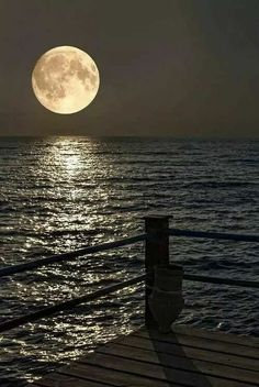 Amazing photograph of the moon God created above the water God created. Genesis 1