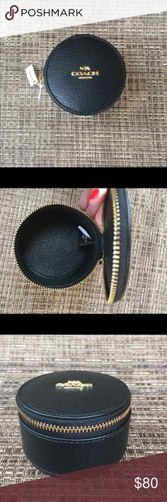Coach Black Leather Circle Jewelry Case Coach Black Leather Circle Jewelry Case.  New with tags.  Gorgeous and classic case to store your valuables when traveling, use as a pill box or store any other valuables in your handbag.  Front their new collection, this is a timeless bag with classic gold logo.  Makes for a perfect gift for the holidays or any special occasion. Coach Bags Travel Bags