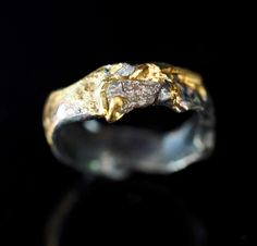 Raw Diamond Engagement Ring With Destroyed Wedding Band