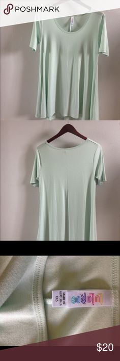 Lularoe Perfect Tee - mint green XXS Beautiful LLR Solid color classic-t adult XXS Worn just a few times  Washed and hung dry  Soft & excellent condition Goes perfectly with the floral leggings in my closet LuLaRoe Tops Tees - Short Sleeve