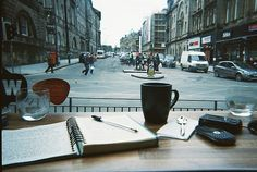 ▲ beautiful morning in a cafe by the street with hot coffee and writing