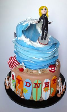 - Surfer girl cake. Modeled after the 8 year old surfer herself (black wetsuit and surfboard colors match her own). Wave made from a combination of carving, gumpaste and royal icing.