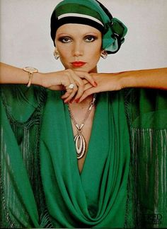 Emerald turban and tassel fringing.