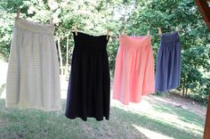 Super easy skirts made out of huge t-shirts. A 30-minute project, start to finish. They're perfect for summertime. They're perfect for when you're pregnant, they're perfect for after you have the baby. They're perfect if you change size or shape or hate your clothes. They're just simply PERFECT. Comfortable, casual, and cheap.