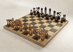 Made from Laser etched/CNC cut maple, with machine-cut oak pieces. The chess pieces stow away in the underside of the board in individual spots assuring that they're all accounted for.