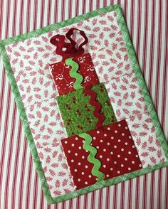 Our December Mug Rug of the Month will help you have a holly jolly Christmas.