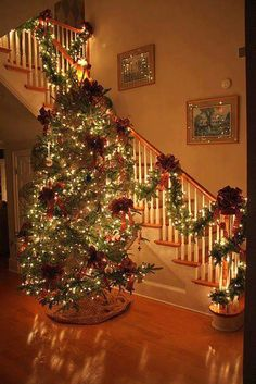 Beautifully lit Christmas tree and stairway