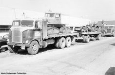 A White Freightliner truck belonging to Public Freightways. Taken in 1959.
