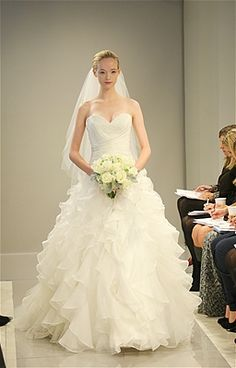 """Photo: Allan Zepeda / The Knot""""  trends from Bridal Week  Ruffles  The ruffles on the skirt of this Theia dress are flirty, while the full skirt and strapless neckline are classic. (The perfect combo!)"""