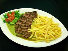 Tagliata con patatine fritte e salsa Steak - Steak with french fries and gravy Steak - Steak Restaurant