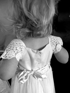 The back of the flowergirl dress - love the lace shoulders.