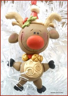 Love this ornament by one of my favorite polymer clay artists! -- Handmade Folk Ornament Reindeer by MichellesClayBeads on Etsy.