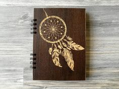 This unique Dreamcatcher Wooden Notebook is great for jotting down your thoughts, ideas, goals, to do lists, etc.  We made this beautiful wood journal for a person who still love to write and draw their thoughts with a pen and paper. And we know how good it feels. But how would it feel to have absolutely personalized engraved pad? We checked – it's also good. So If you love using personal notebooks instead of apps or you know someone who does – this stuff will make a perfect present. Think…