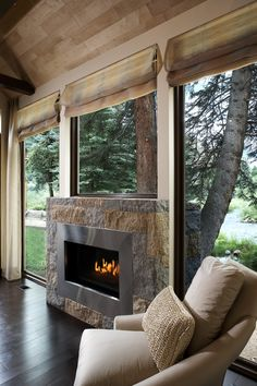 Beautiful Fireplace with a view of nature HarrisonBrowne.com