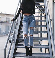 Black crop top, ripped boyfriend jeans, black heels