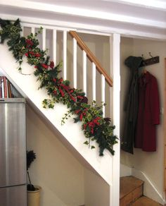 Garland at base of exposed staircase instead of wrapped around the banister.