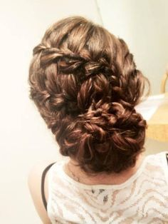 I think it's just a backwards 's' braid and then made into a bun.