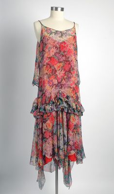 1920's Adoria Loeser's bias cut sheer floral silk chiffon dress. Made of floral chiffon, with ruffles , a back cape and french braided straps..... such a dreamy creation.