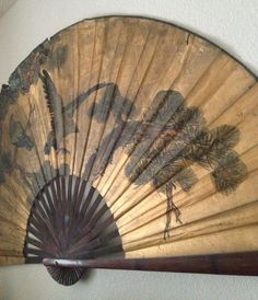 Round curved vintage Asian fan.