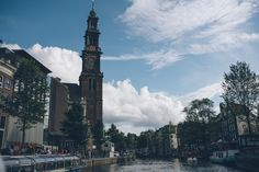 Amsterdam canals boat ride city of love summer architecture old vs new cathedral