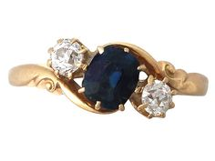 '0.98 ct Sapphire and 0.40 ct Diamond Twist Ring - Antique' http://www.acsilver.co.uk/shop/pc/0-98-ct-Sapphire-and-0-40-ct-Diamond-18-ct-Yellow-Gold-Twist-Ring-Antique-1911-35p8568.htm