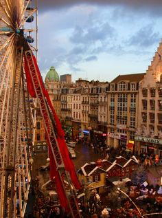 Lille Christmas Market, France  A ferris wheel dominates teh main square.   Try: maroilles cheese, chicory pate, macaroons and babeluttes Buy: local arts, crafts & regional food specialities