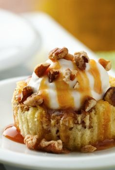 """A yummy Bisquick batter, apples and cinnamon bake up to make impossibly delicious little """"apple pies"""" topped with whipped cream, caramel, pecans and sea salt!"""