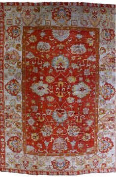 A Turkish Oushak rug BB2809 - by Doris Leslie Blau. A late 19th century Turkish Oushak (Ushak) antique rug, the tomato red field with an enlarged palmette, cloud band ...