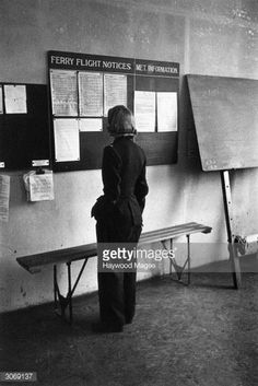 One of the ferry pilots of the ATA , who transport newly manufactured aircraft from the factory to the aerodrome during World War II scans the flight notices for her next assignment. Get premium, high resolution news photos at Getty Images Code Name Verity, Ww2 Women, Fear Of Flying, British Airways, Royal Air Force, Looking Back, World War Ii, Troops, Wwii