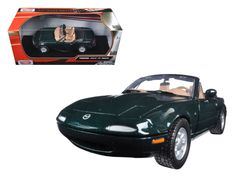 Mazda Miata MX-5 Green 1/24 Diecast Model Car by Motormax - Brand new 1:24 scale diecast model car of Mazda Miata MX-5 Green die cast car model by Motormax. Brand new box. Rubber tires. Made of diecast with some plastic parts. Detailed interior, exterior. Has opening hood, doors and trunk. Dimensions approximately L-7, W-3.25, H-2.75 inches. Please note that manufacturer may change packing box at anytime. Product will stay exactly the same.-Weight: 2. Height: 6. Width: 11. Box Weight: 2. Box…