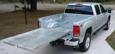 Buy a Hinton bed slide and add your own platform...or buy one of theirs.
