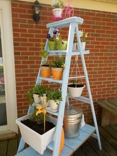 For a decidedly less construction-heavy project, neatly stack pots on the rungs of a ladder. For a bit more flourish, add a hook for a hanging planter. Get the tutorial at Small Town Rambler.