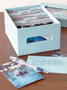 20 Creative Scrapbooking Storage Solutions: Store Your Images - Store your prints in archival photo boxes to keep them in perfect condition while they wait to be scrapped. Create tabs for each topic or time range, making it easy to return to later.
