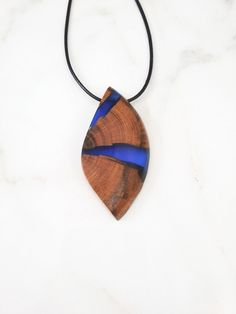 Deep blue resin and reclaimed wood pendant necklace. Epoxy and wood jewelry. Handmade jewelry by WoodAllGood. #WoodAllGood