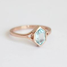 Modern aquamarine ring with split shank. Simple and elegant. Same ring can be also made with other gemstones per request. Product info: 14k gold /18k rose, white or yellow gold. aquamarine measures 6.5 x 4.5mm - 6x 4mm Ring is 1.8mm wide IF YOU WANT A CUSTOM ring please contact us before