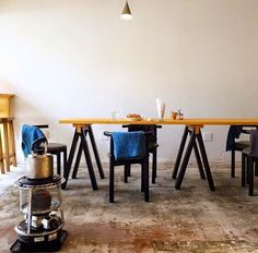 galleria_salone cafe space long wood table, black chairs, & made in japan…