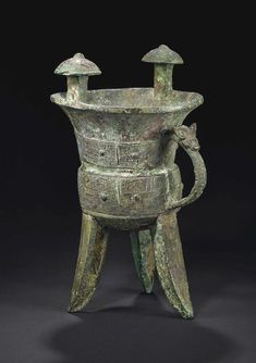 A large bronze tripod wine vessel, jia, China, Shang dynasty, 13th-11th Century BC.