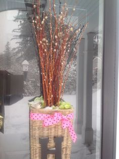 "Pussy willow filled monogrammed basket for an early spring front door ""wreath"""