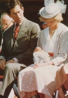 ...he loves me...he loves me not...what could Charles be fussing at Diana about? Was her lip not stiff enough?