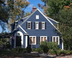 Quaint Small House With Blue Wood Siding And White Windows The Dark Navy Shutters Surround Each Window Finish This Clic Color Scheme
