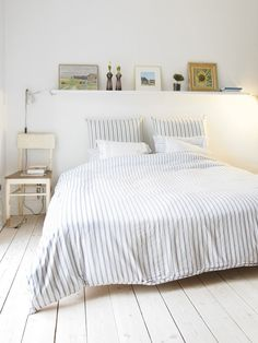 For the spare bedroom? Floating shelf above bed and two bedside stools.