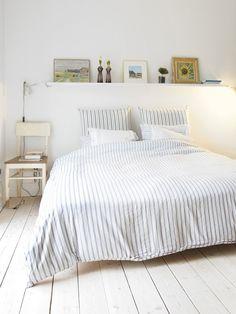 decorative shelf above bed / bolig