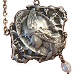 An elegant antique Art Nouveau pendant created by Belgian sculptor Lucien Joseph Rene Janvier.  This wonderful art jewelry is crafted in silver and