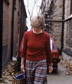 1980: Lady Diana surrounded by press reporters as she leaves her flat to work.