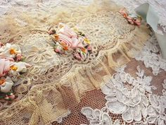 beautiful ribbon roses on antique french net lace