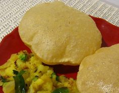 . Made with wheat flour, this Indian bread puffs up when deep-fried ...