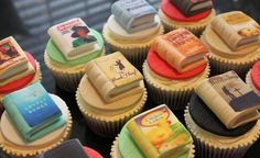 Victoria's Kitchen:   More Book Cupcakes out of the kitchen this morning. These are for a lady celebrating her 60th Birthday, and feature some of the books that have shaped her life, including Christiano Ronlado's autobiography and Chicken Licken! :)