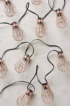 Caged Bulb String Lights Rose Gold outdoor patio lighting from Anthropology My New Room, My Room, Samsung Wallpapers, Deco Rose, Bijoux Design, Copper Rose, Stylish Home Decor, Deco Design, Fairy Lights